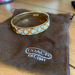 Coach orange and while bangle bracelet.